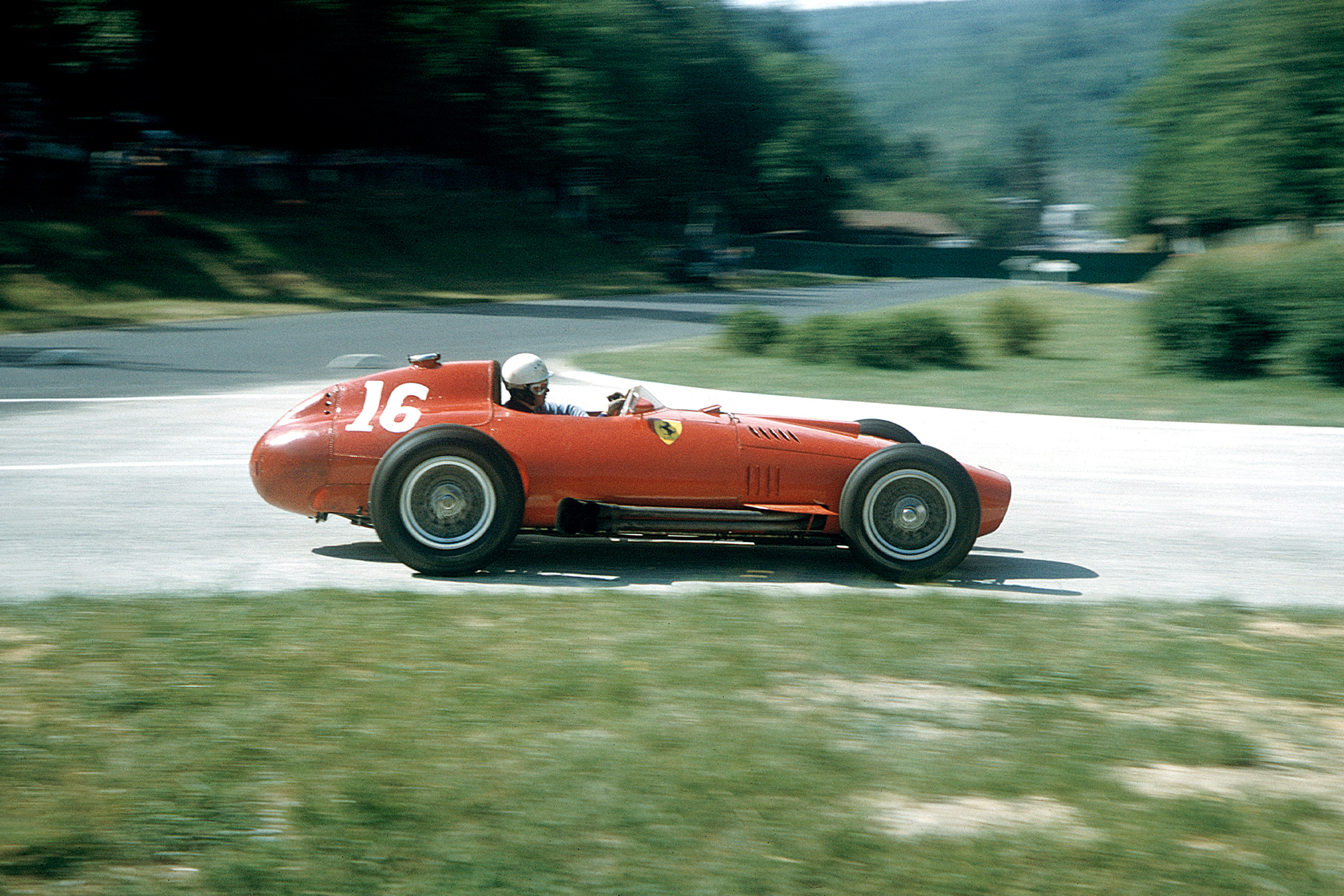 Maurice Trintignant (Lancia-Ferrari 801) takes a corner at the 1957 French Grand Prix, Rouen.