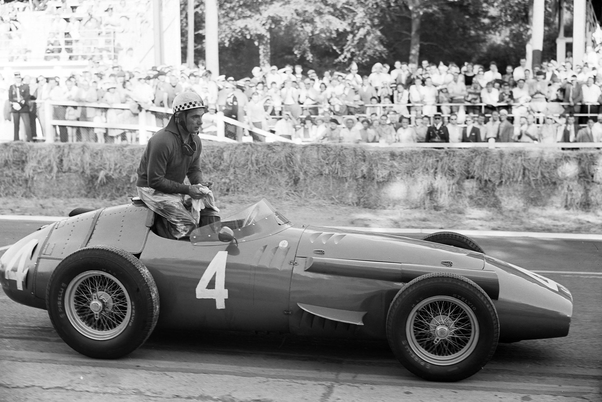 Jean Behra sits on top of his Maserati 250F, 1957 French Grand Prix, Rouen.