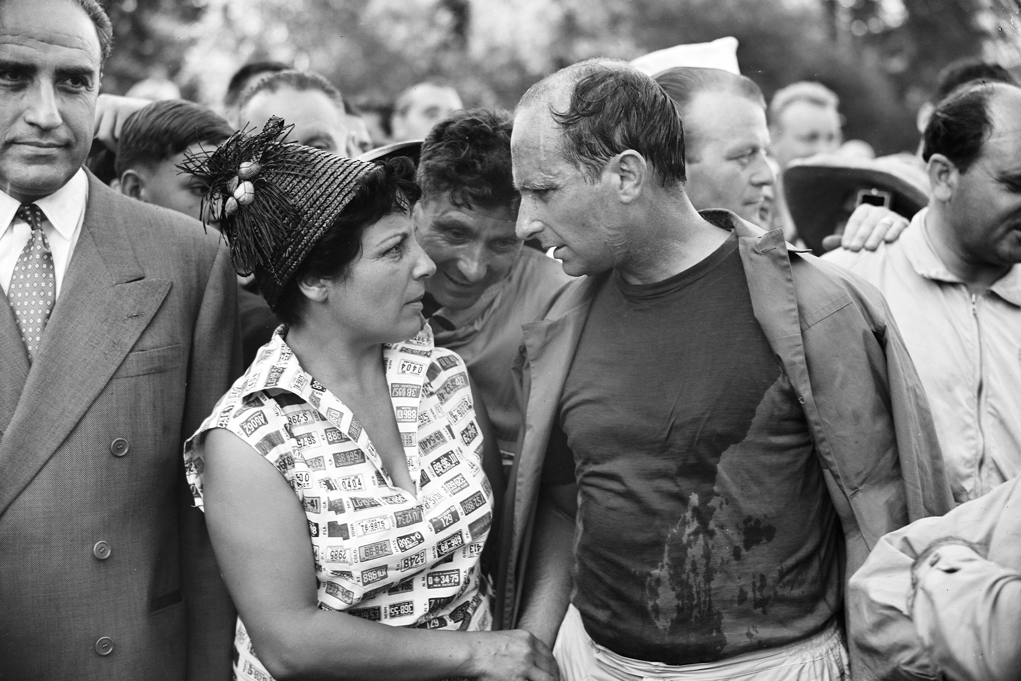 Juan Manuel Fangio celebrates his win at the 1957 French Grand Prix, Rouen
