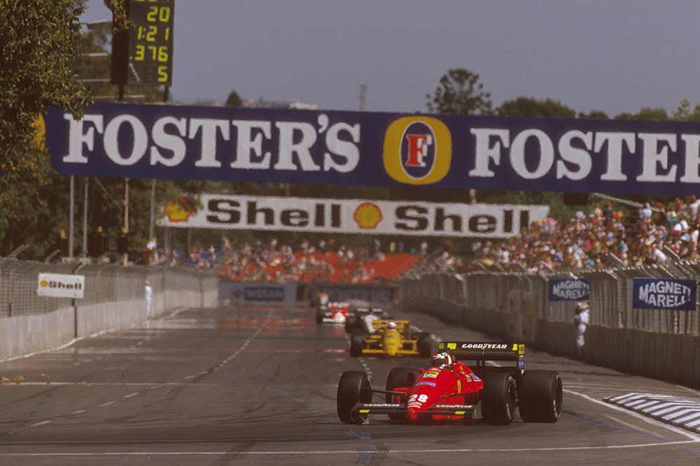 Gerhard Berger leads in his Ferrari F187.