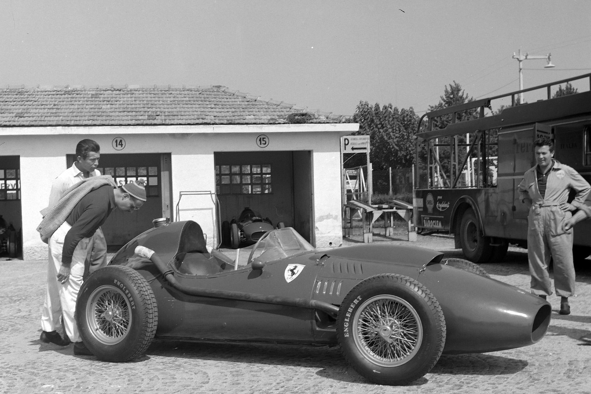 A Ferrari 246 in the paddock