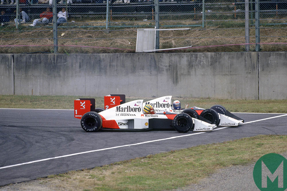 Ayrton Senna and Alain Prost crash together at the 1989 Japanese Grand Prix