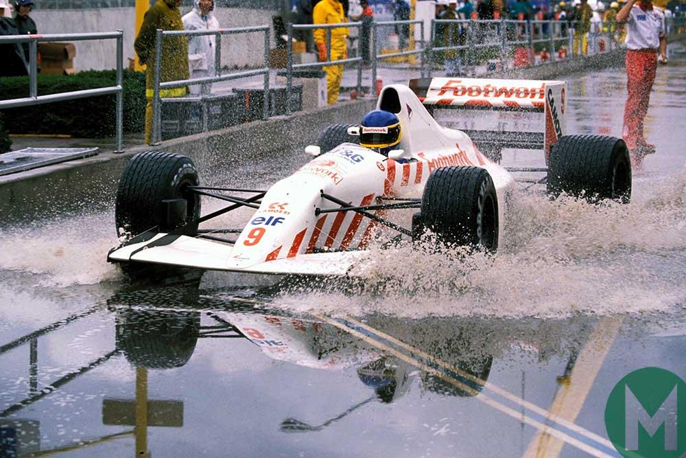 Michele Alboreto splashes through the wet pitlane in Phoenix at the US Grand Prix