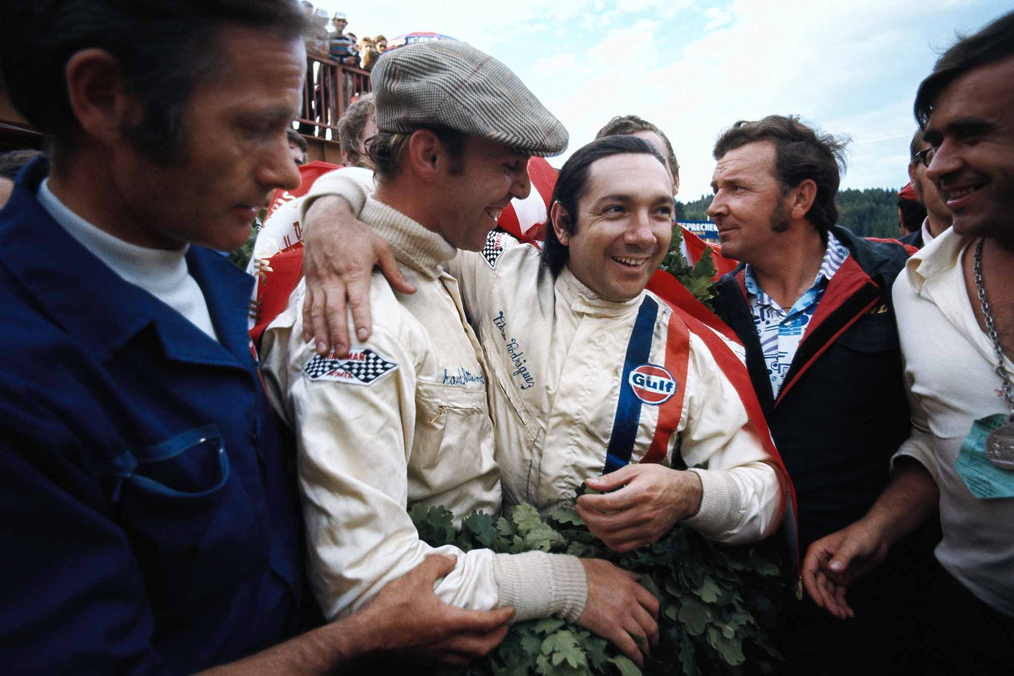 Pedro Rodriguez and Richard Attwood celebrate winning the Austrian 1000km in their Porsche 917