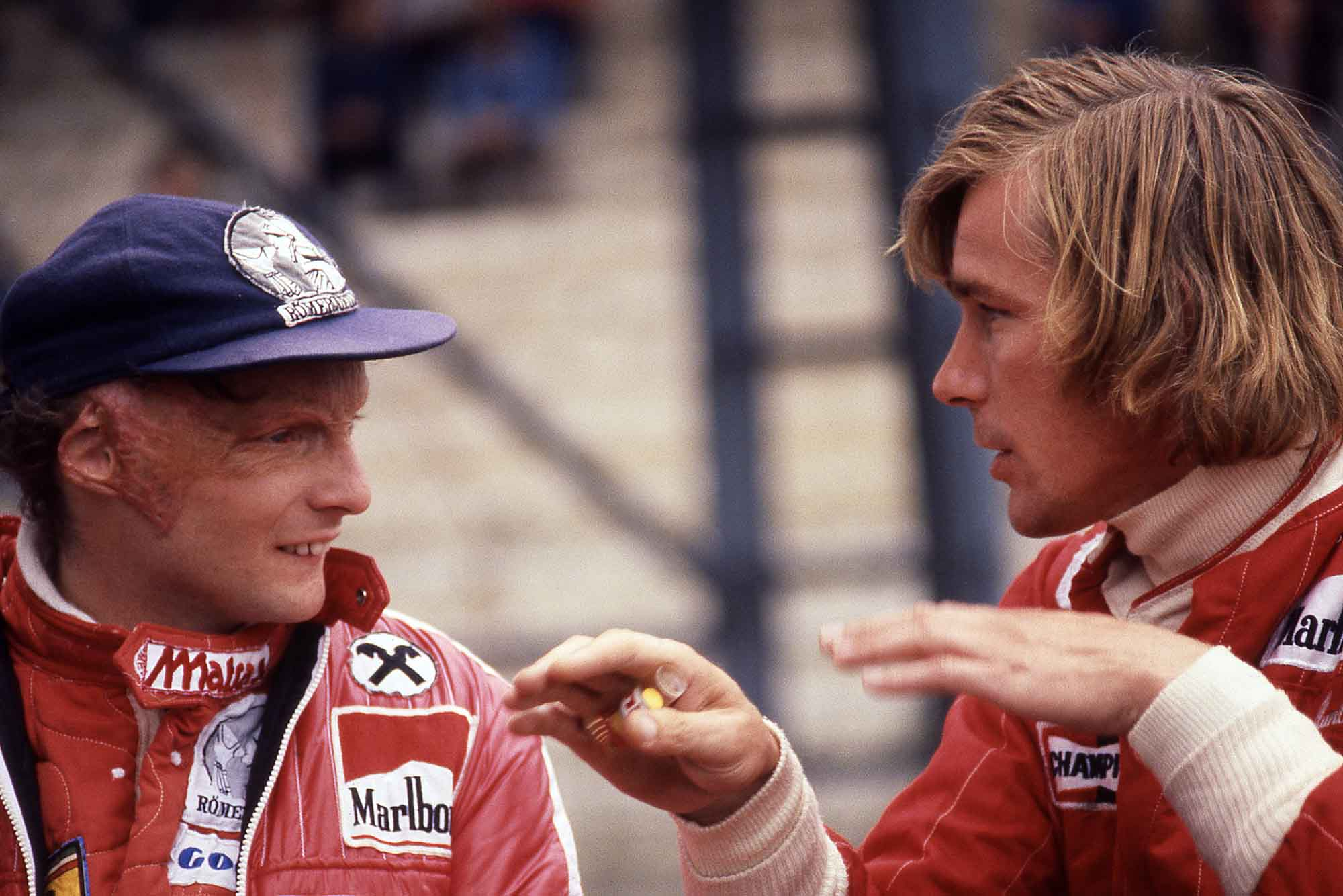 Niki Lauda of Ferrari confers with James Hunt of McLaren at 1976 Belgium Grand Prix