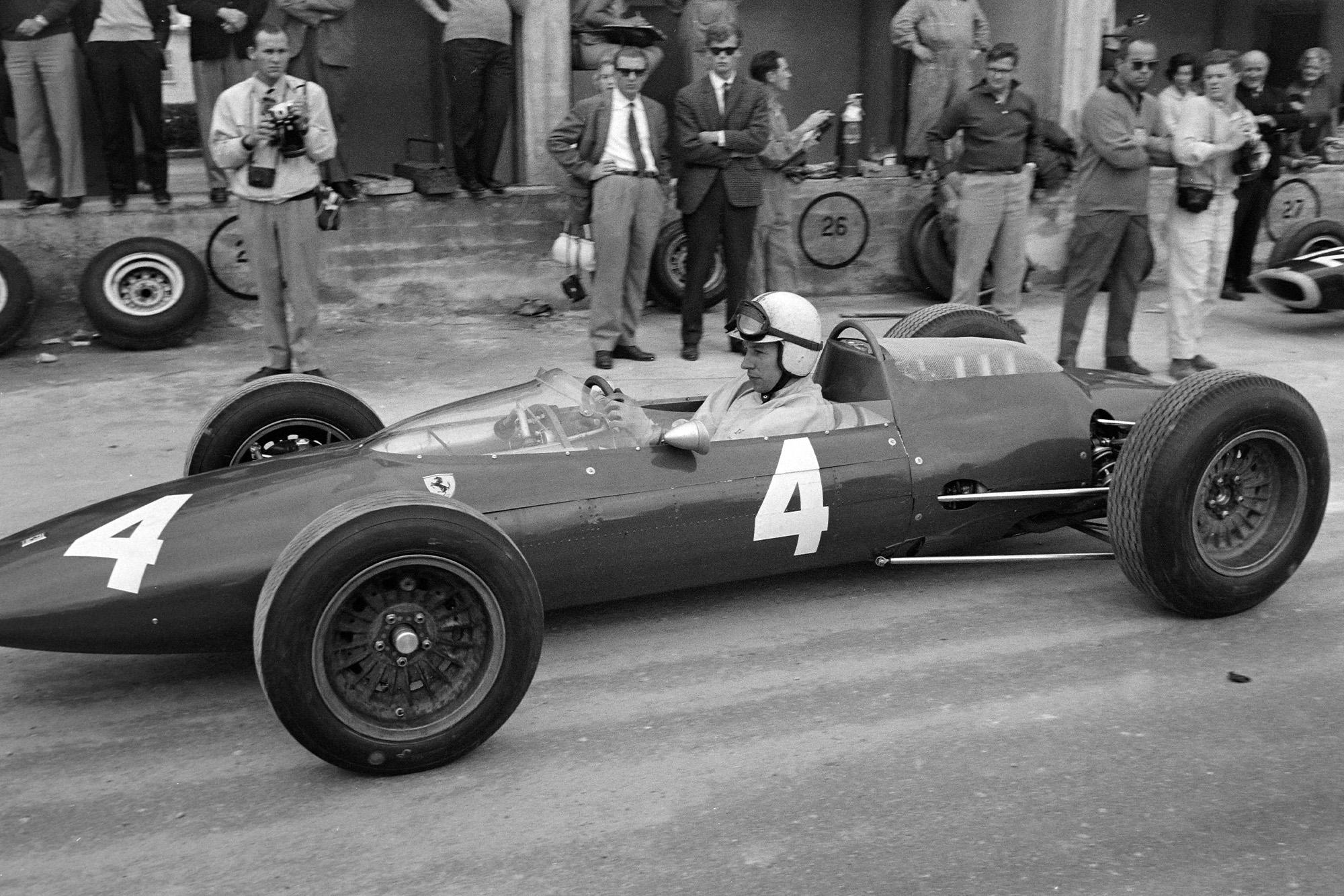 John Surtees, Ferrari 156 Aero, pulls out of the pits.