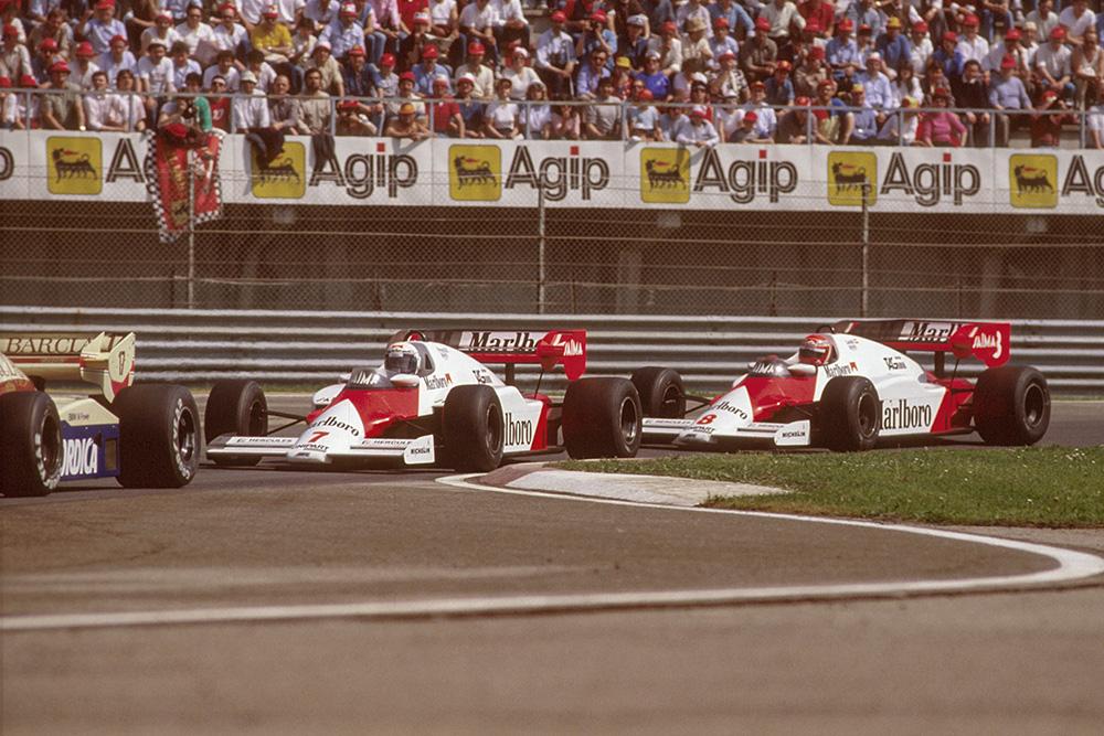 Alain Prostin a McLaren MP42 TAG Porsche racing closely with teammate Niki Lauda.