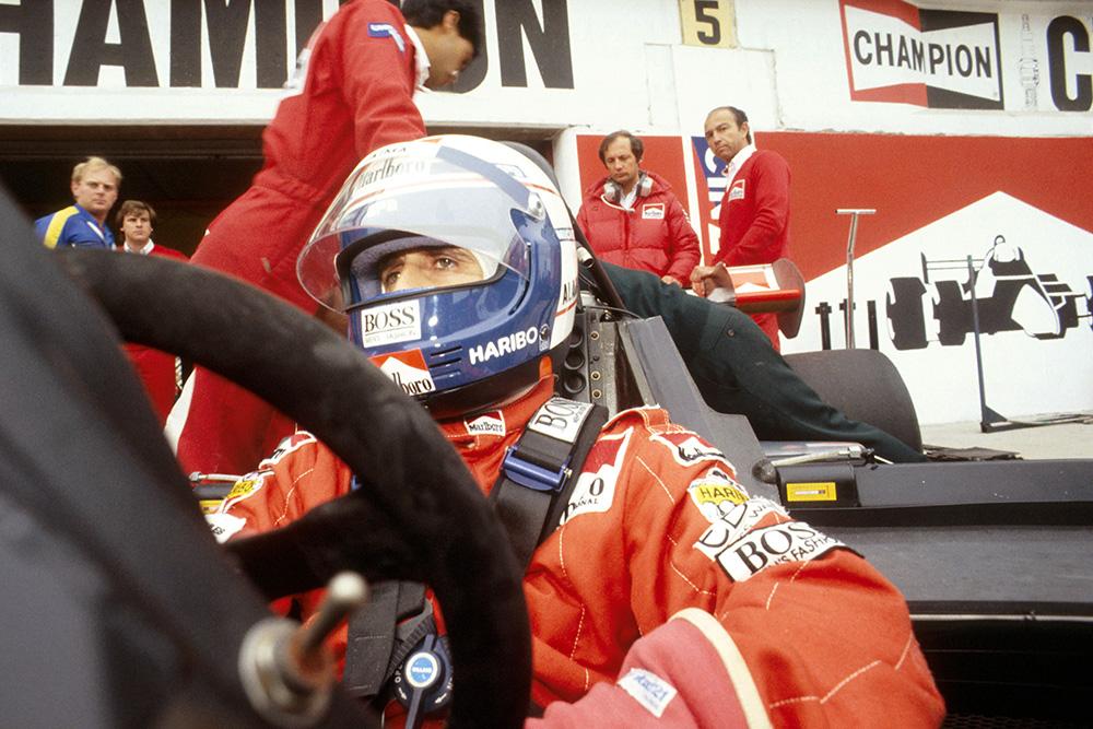 Alain Prost prepares in his McLaren MP42 TAG Porsche.