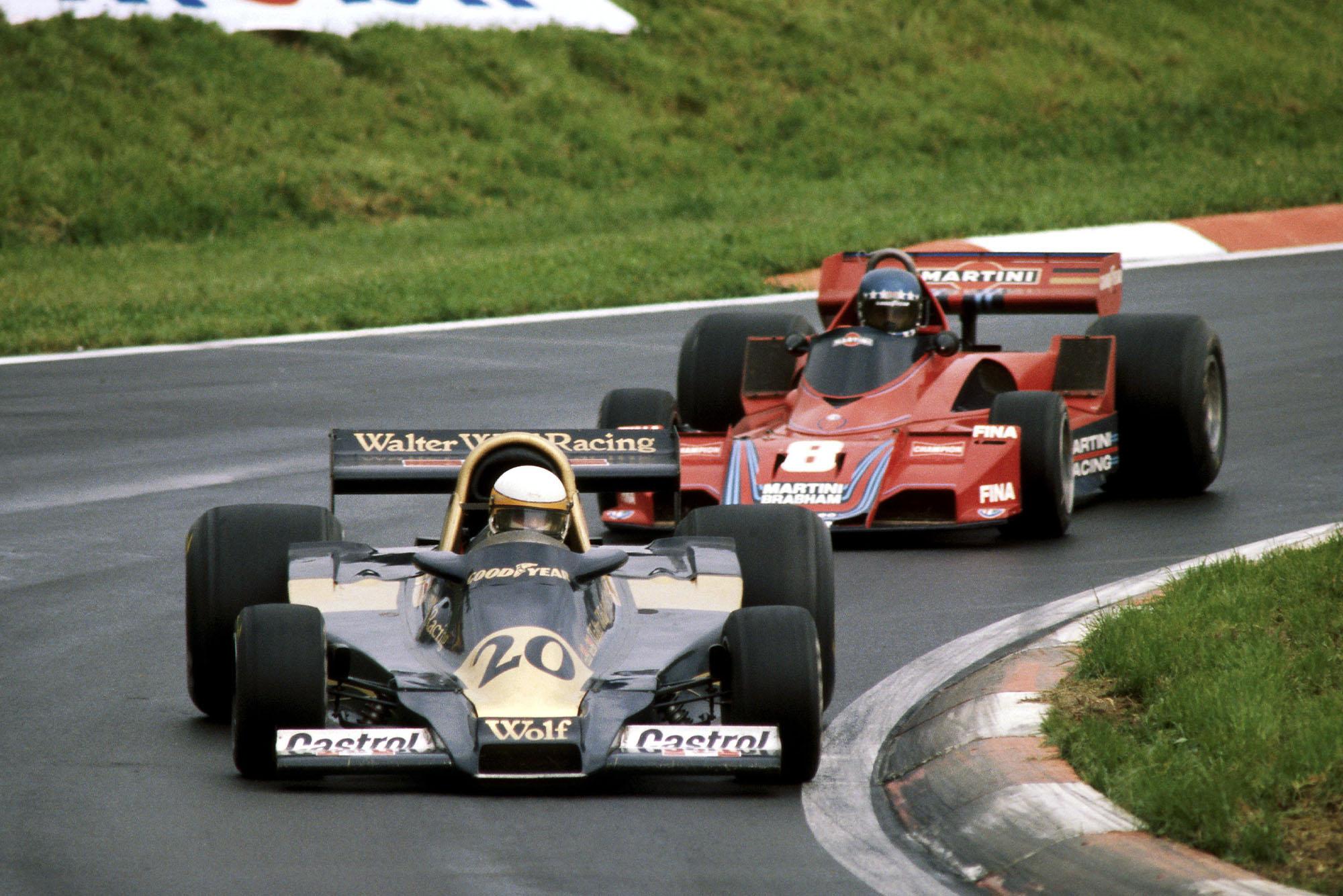 Jody Scheckter (Wolf) leads Hans-Joachim Stuck's Brabham at the 1977 Austrian Grand Prix, Österreichring.