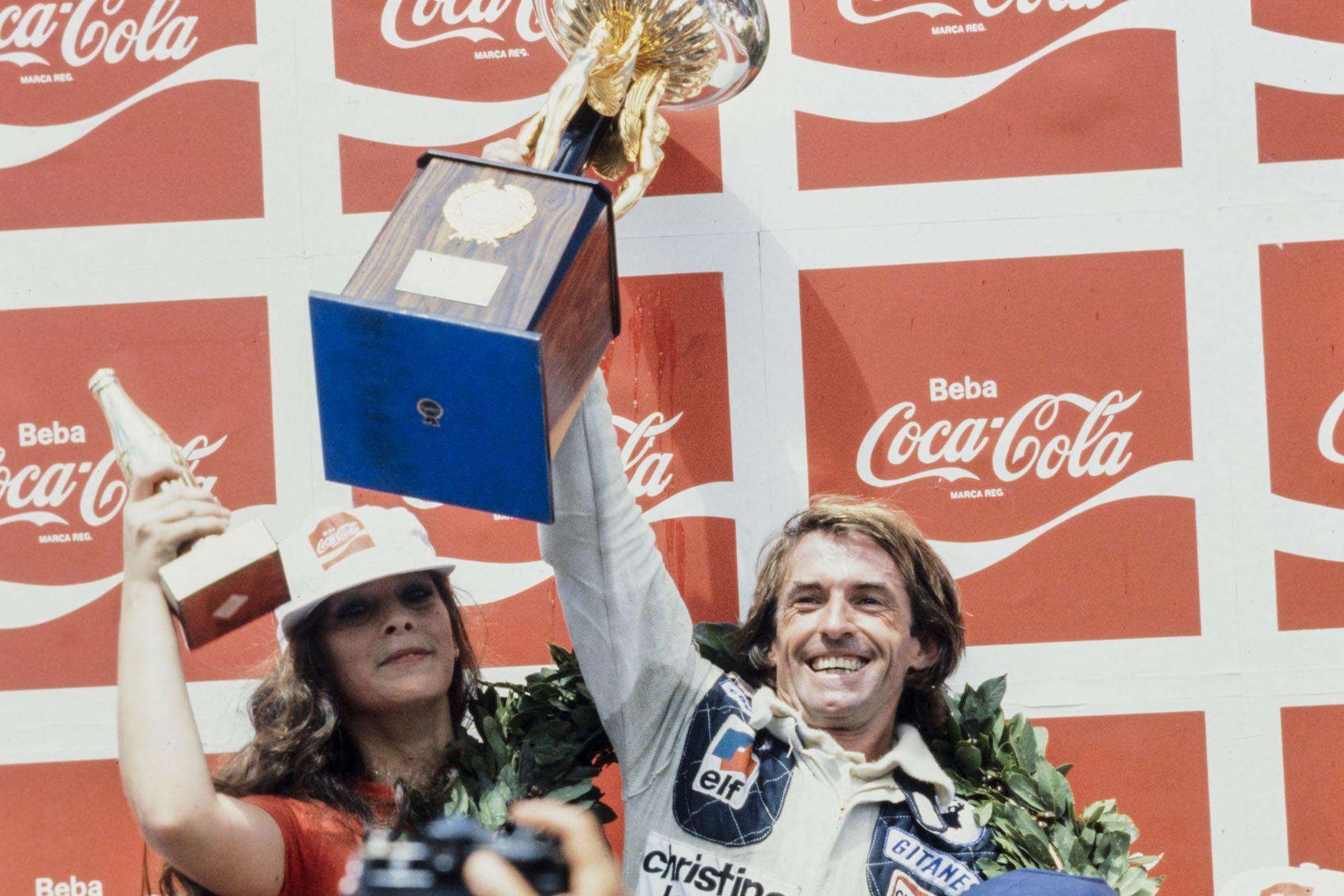 Jacques Laffite (Ligier) celebrates on the podium after winning the 1979 Brazilian Grand Prix.