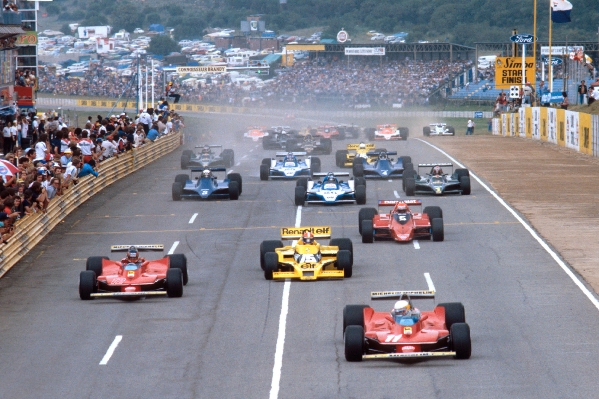 The cars race down to the first corner at the 1979 South African Grand Prix.
