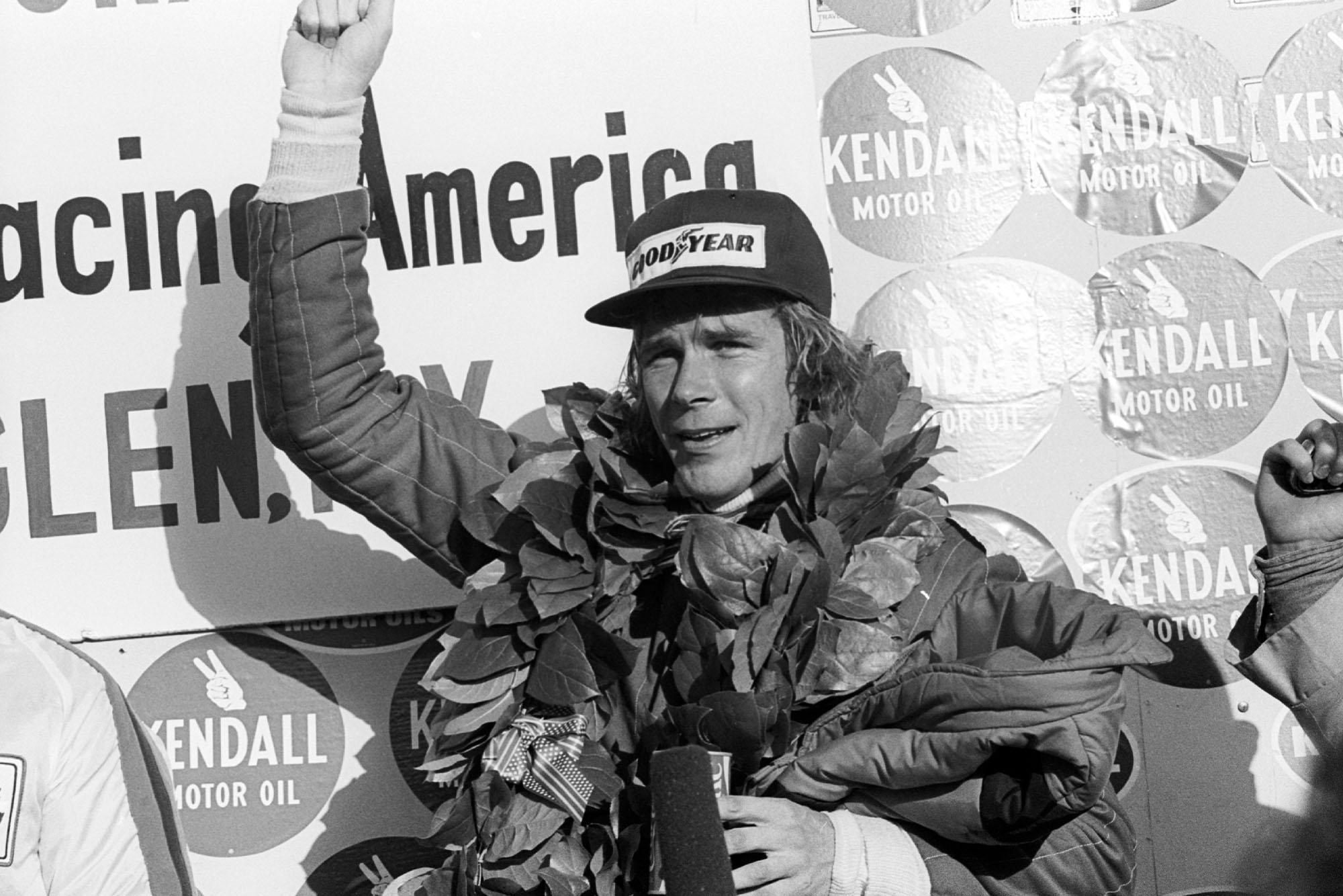 James Hunt (McLaren) celebrates his win on the podium at the 1976 United States Grand Prix East, Watkins Glen.
