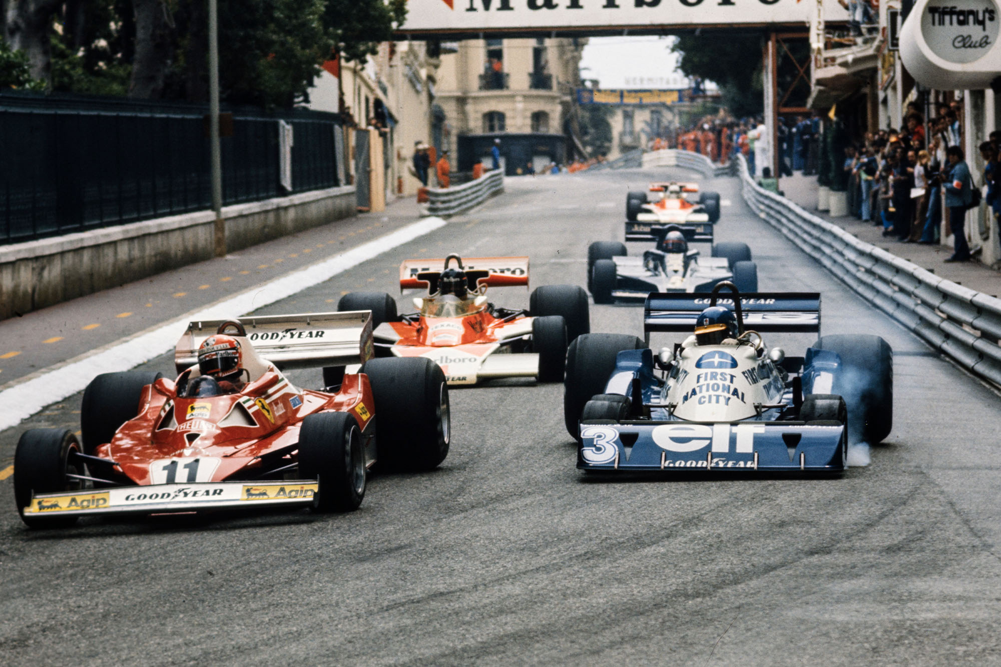 Niki Lauda (Ferrari) fights with Ronnie Peterson Tyrrell at the 1977 Monaco Grand Prix.