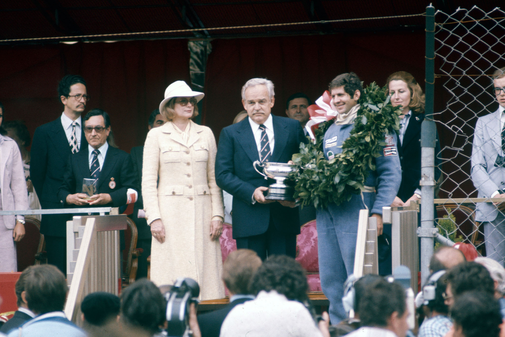 Jody Scheckter (Wolf) stands on the podium after winning the 1977 Monaco Grand Prix.