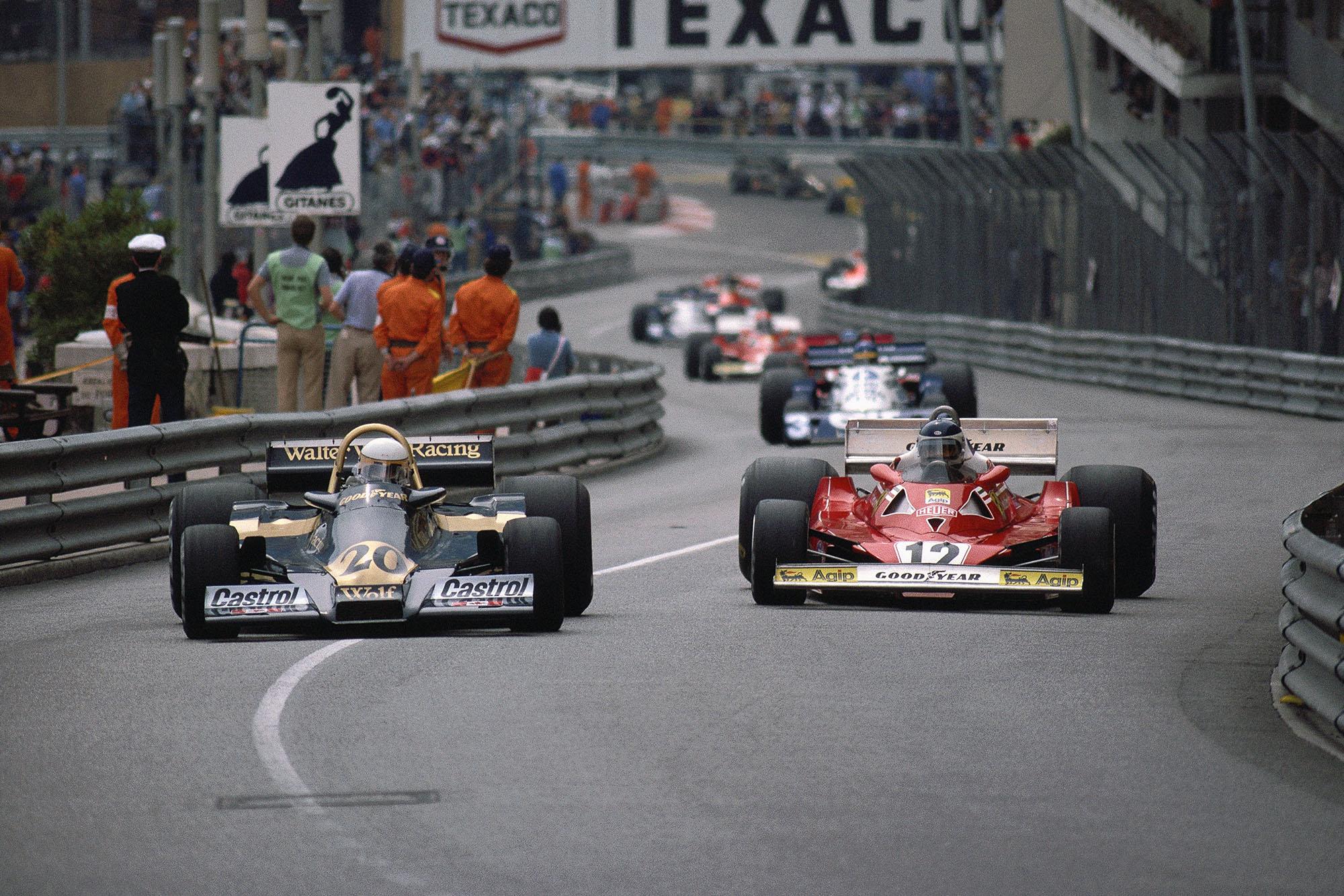 Jody Scheckter (Wolf) dices with Carlos Reutemann (Ferrari) at the 1977 Monaco Grand Prix.