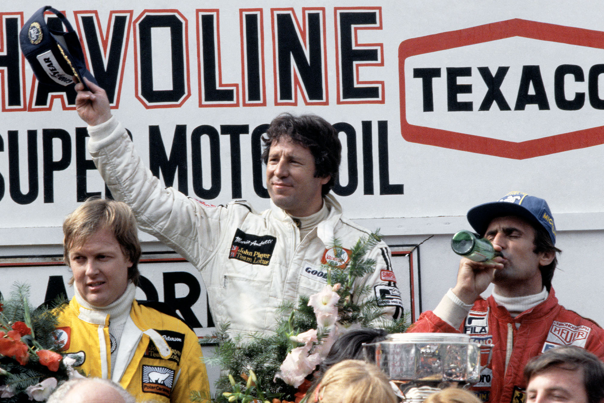 Mario Andretti (Lotus) acknowledges the crowd after winning the 1978 Belgian Grand Prix, Zolder.