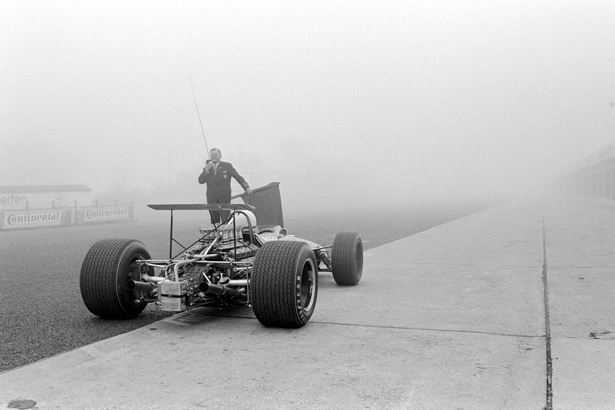 A Brabham BT26 prepares to enter a fog covered Nurburgring.