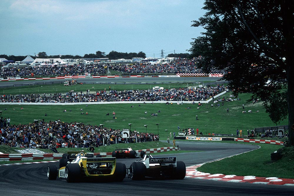 Rene Arnoux in a Renault RE24 battles with Hector Rebaque in his Brabham BT49.