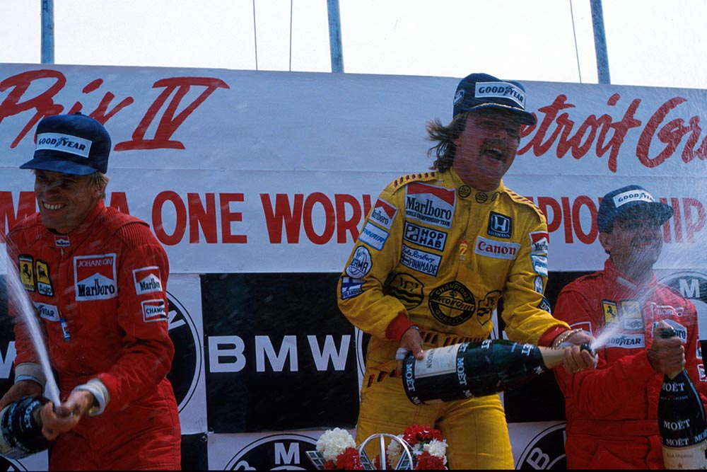 Winner Keke Rosberg celebrates on the podium with Stefan Johansson and Michele Alboreto.