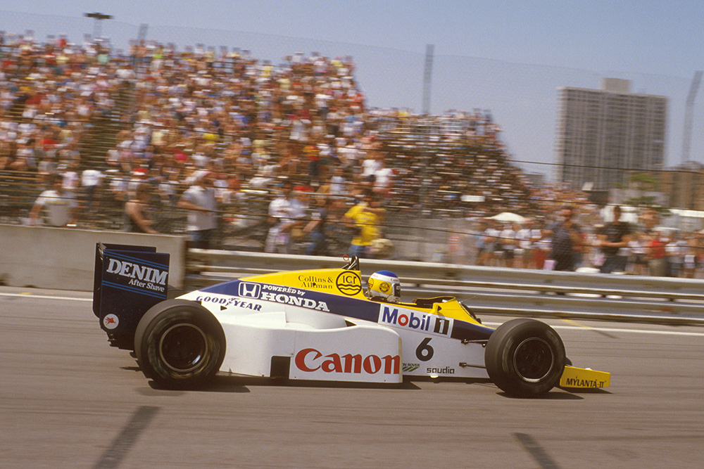 Keke Rosberg leading in his Williams FW10 Honda.