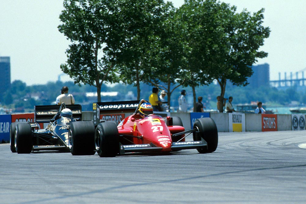 Michele Alboreto (Ferrari 156/85) is chased by Elio de Angelis (Lotus Renault 97T). US Grand Prix, Detroit, 23 June 1985
