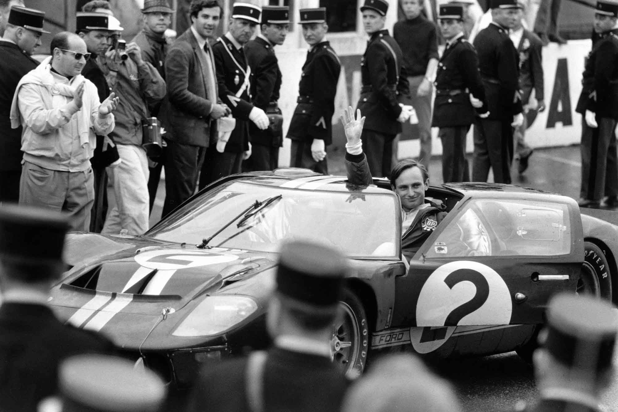 Amon waves to the crowd after winning the 1966 Le Mans in his Ford GT40 MkII