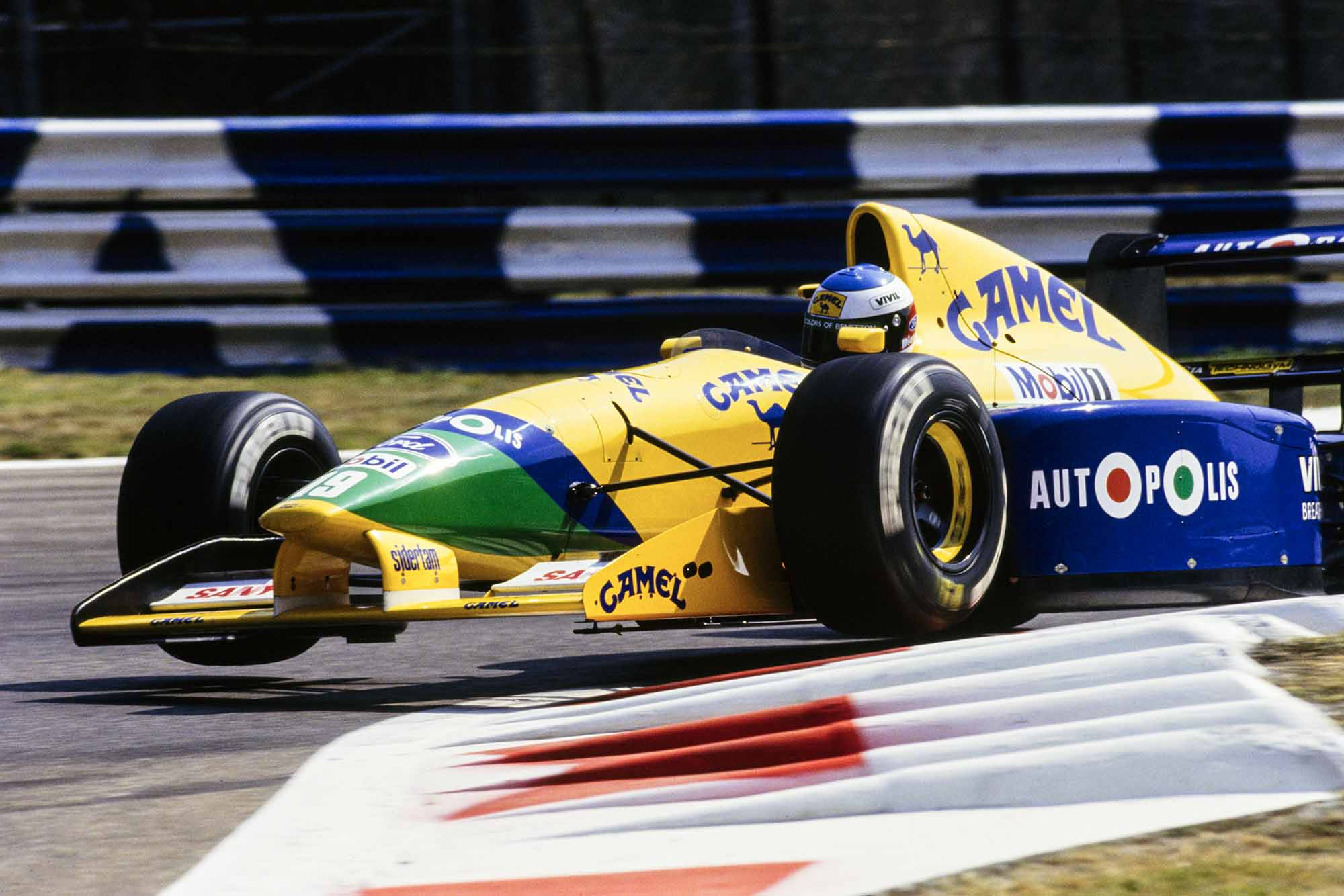 Michael Schumacher flies over chicane in his Benetton at the 1991 Italian Grand Prix