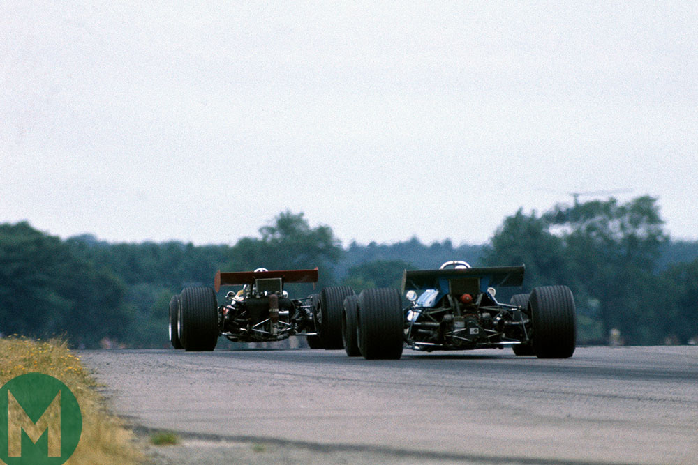Jackie Stewart (Tyrrell - Matra) chases after the Lotus of Jochen Rindt