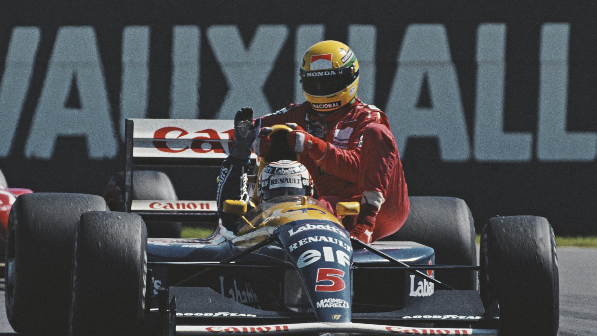 Nigel Mansell gives Ayrton Senna a lift after the 1991 Biritsh Grand Prix