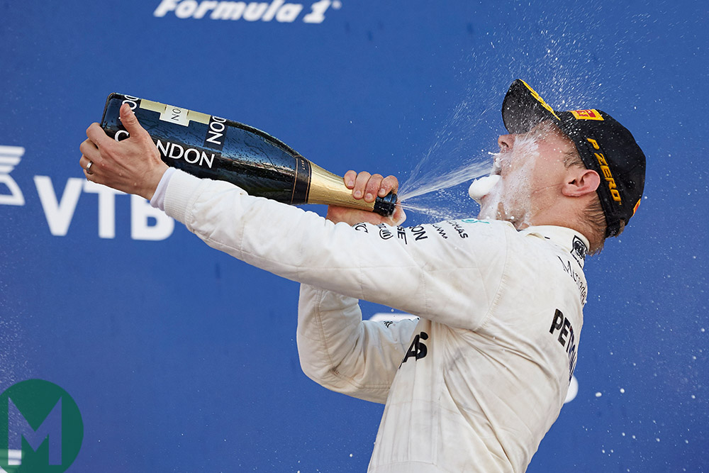 Valtteri Bottas sprays champagne into his mouth after winning the 2017 Russian Grand Prix