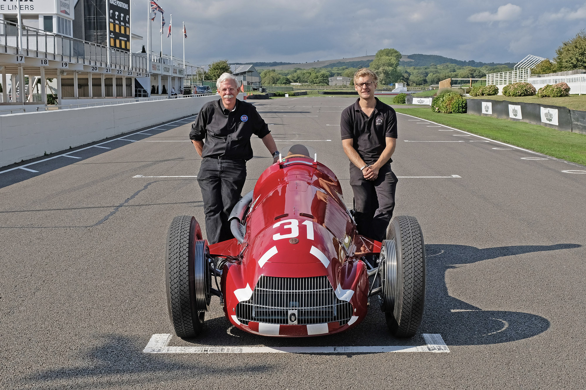 Jim Stokes and James Holloway with their restored Alfa 158