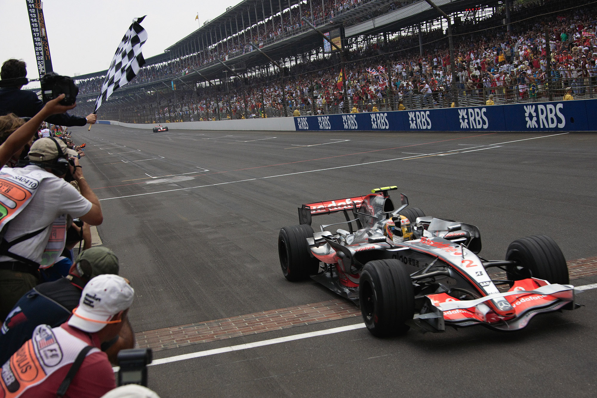 Lewis Hamilton crosses the brick-lined finish line to win the 2007 US Grand Prix at Indianapolis