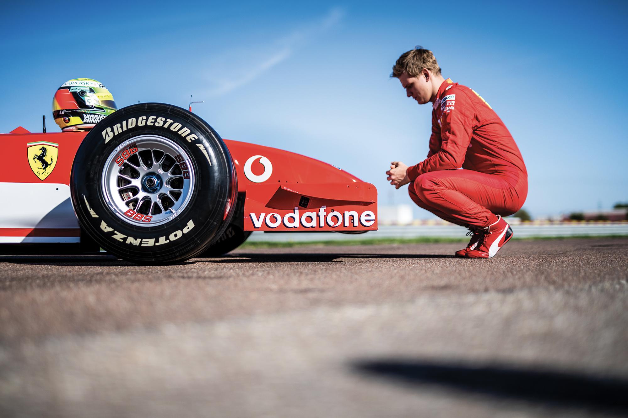 Mick Schumacher next to Michael Schumacher's F2002 Ferrari