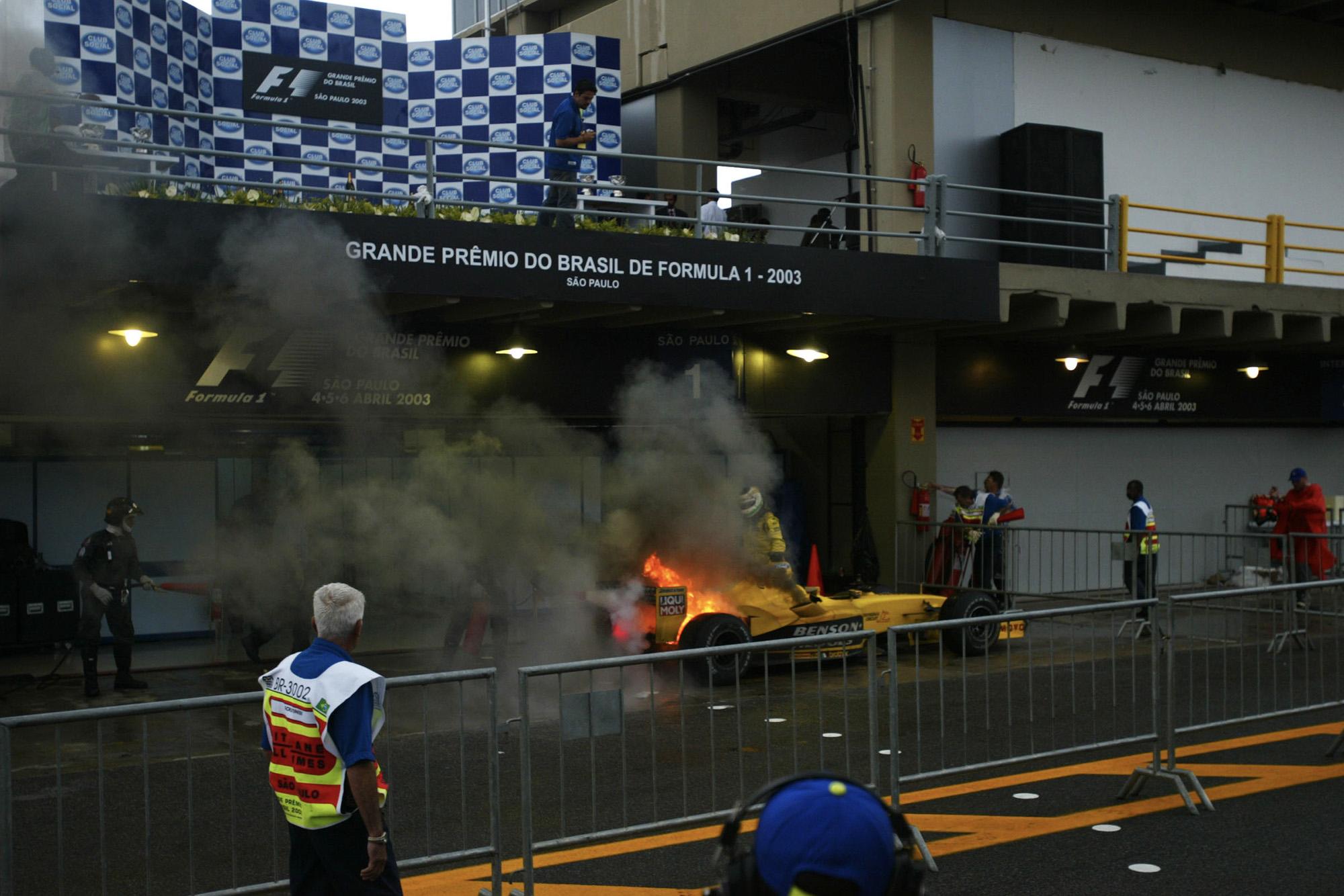 Giancarlo Fisichella's Jordan catches fire at the end of the 2003 Brazilian Grand Prix