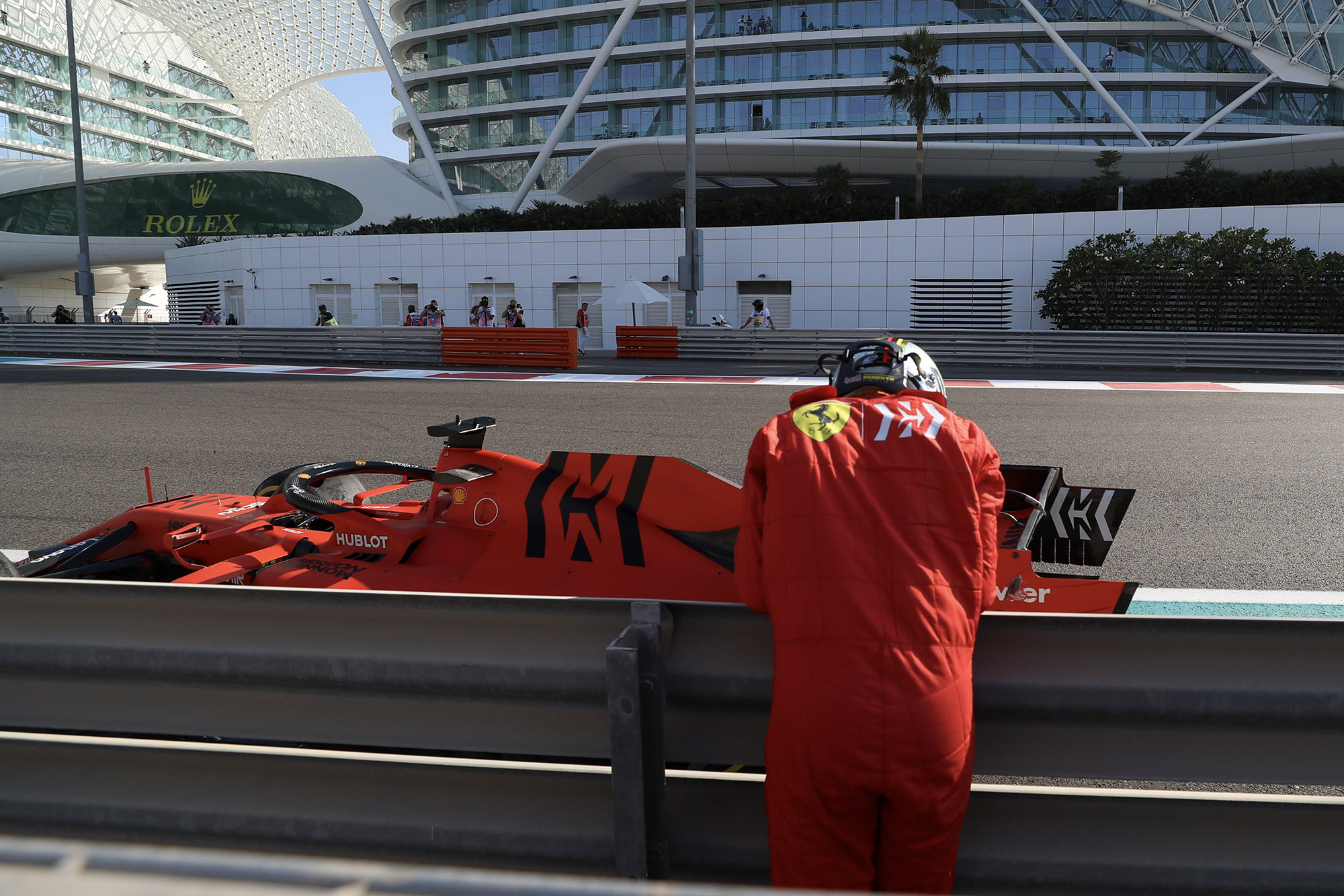 Sebastian Vettel leans against the barrier after crashing out of FP1 ahead of the 2019 Abu Dhabi Grand Prix