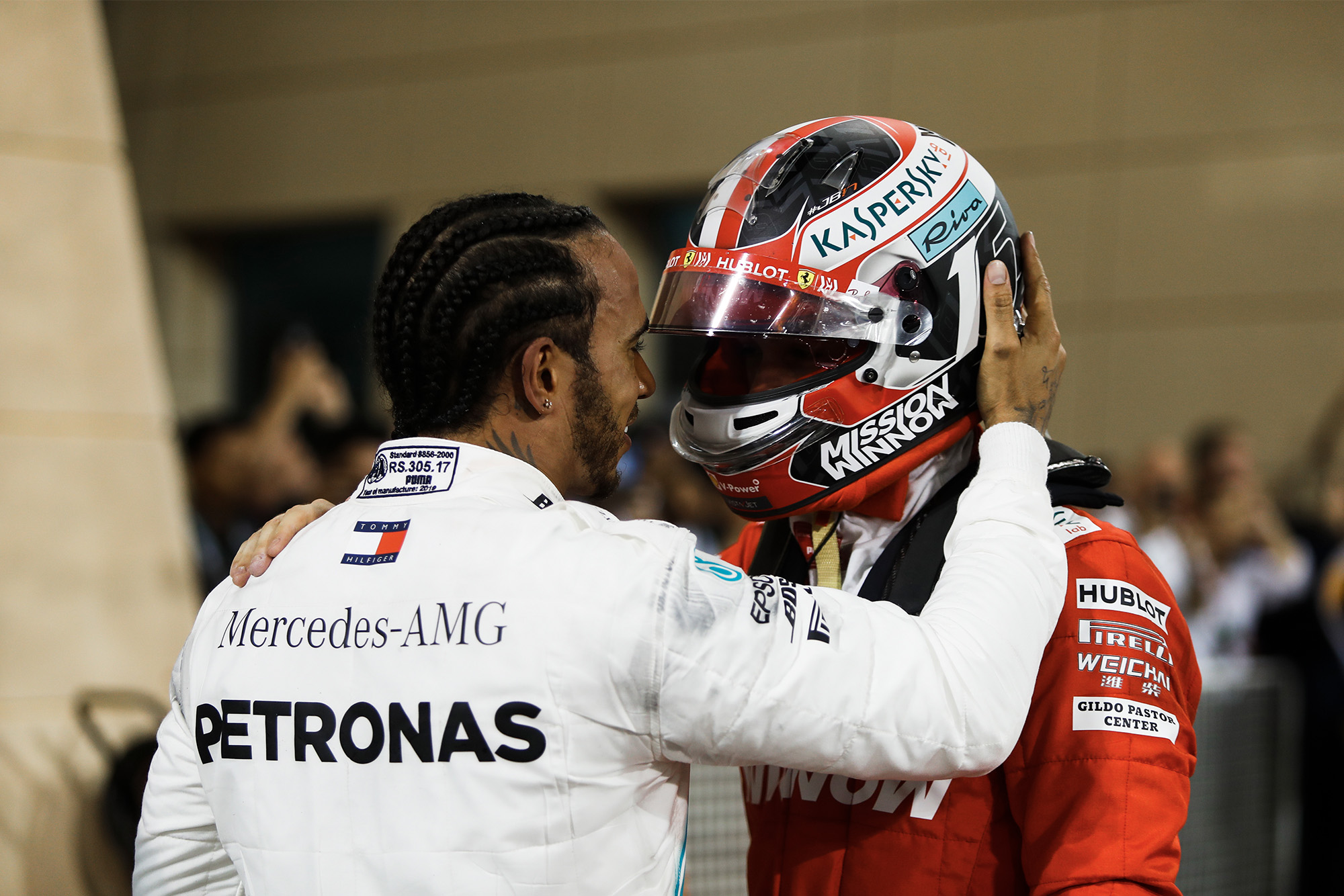 Lewis Hamilton embraces Charles Leclerc after the Bahrain Grand Prix