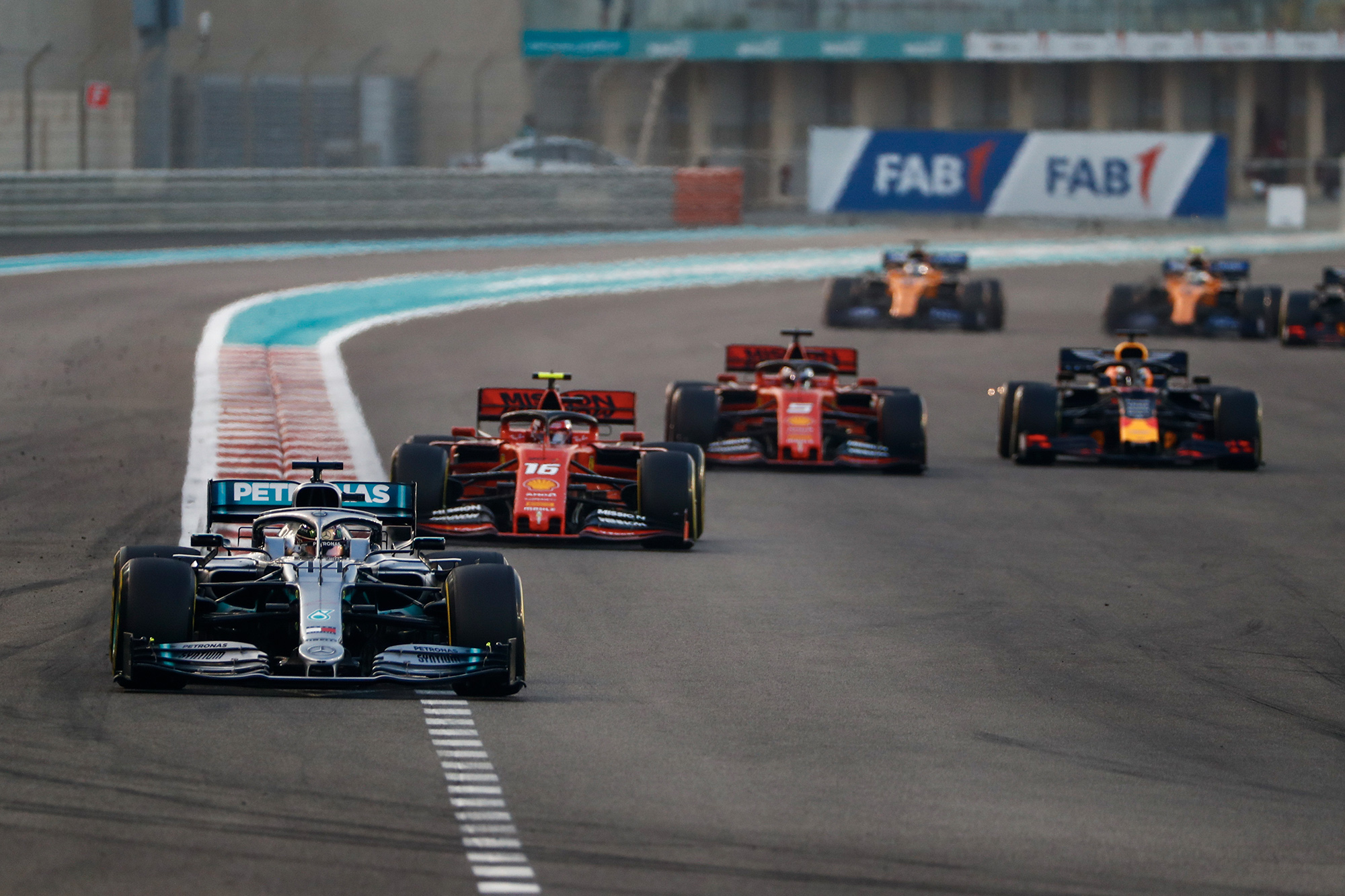 Max Verstappen defends against Sebastian Vettel on the first lap of the 2019 Abu Dhabi Grand Prix