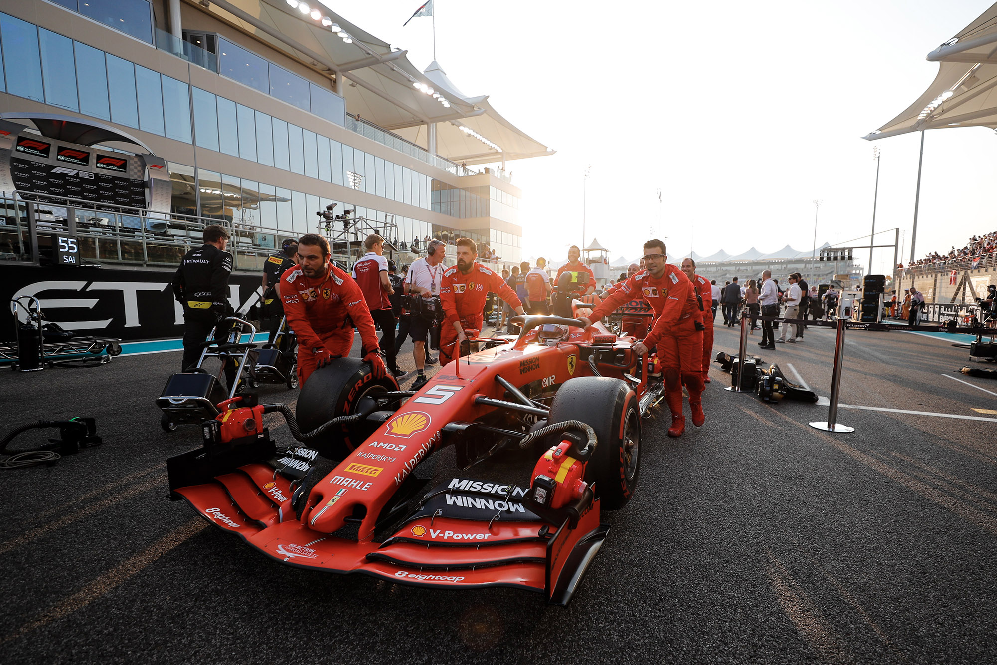 Charles Leclerc's car is pushed to the grid ahead of the 2019 Abu Dhabi Grand Prix