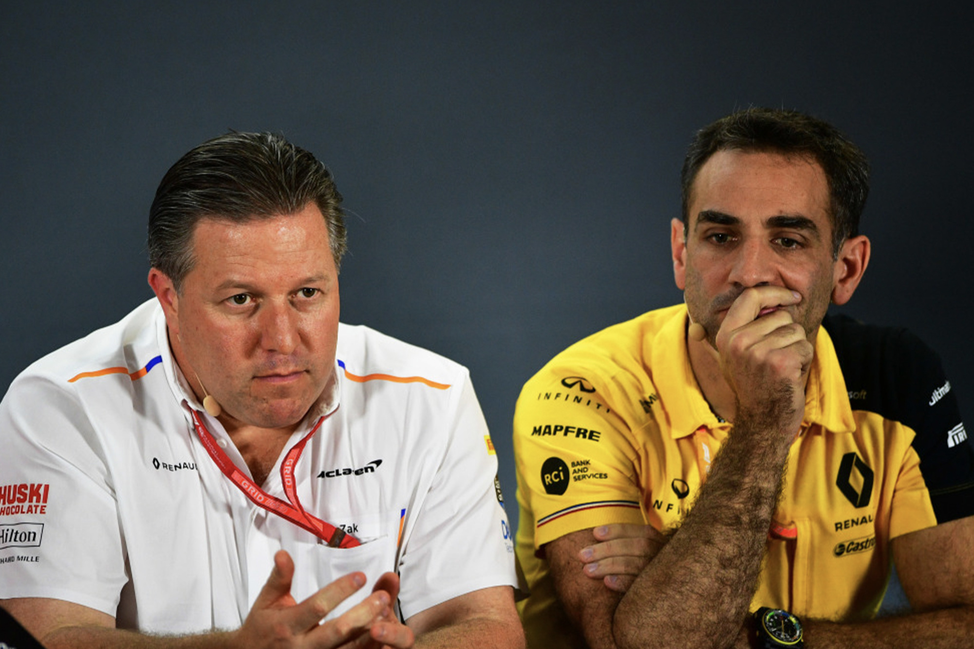 Zak Brown sitting next to Cyril Abiteboul in an F1 press conference