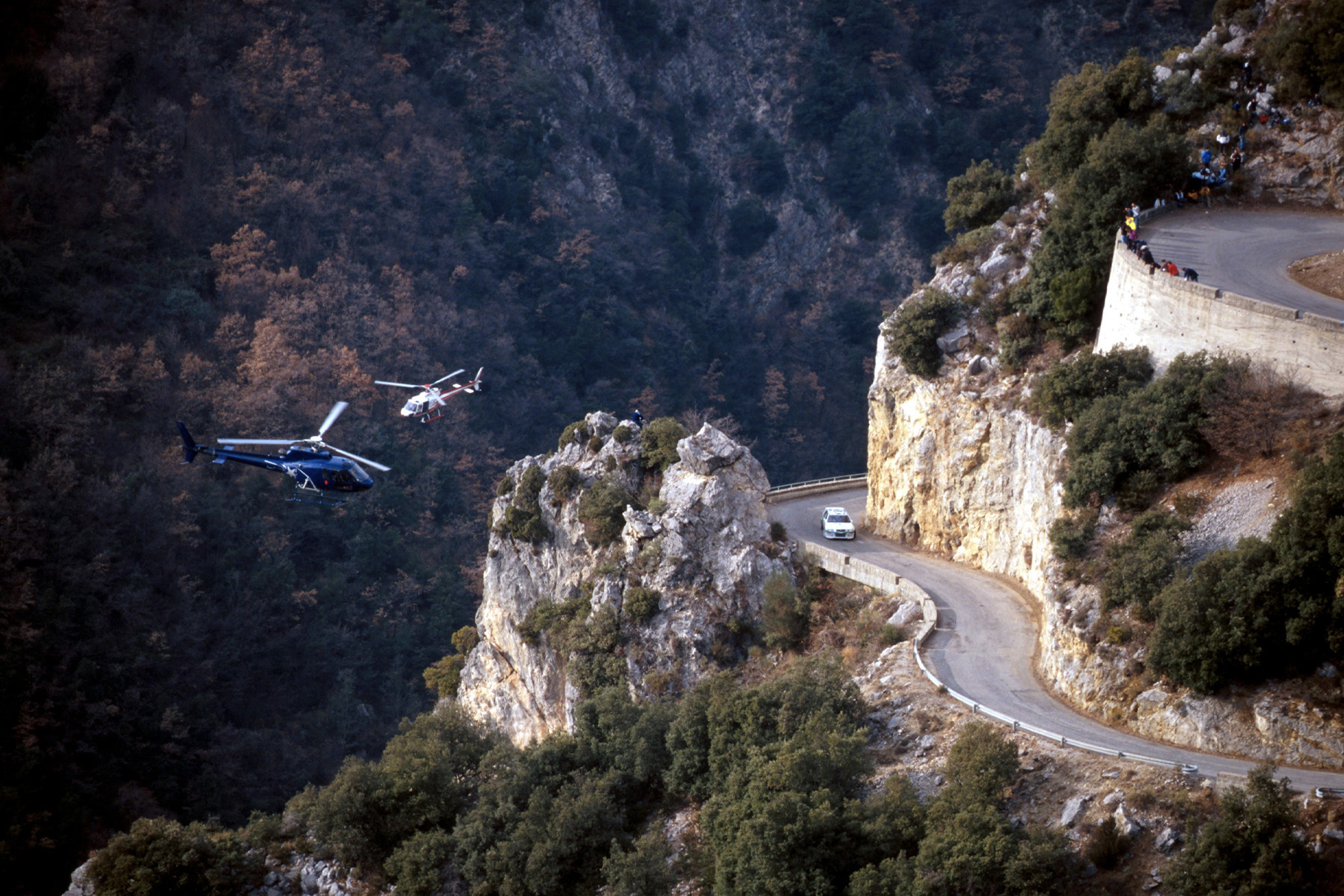 A Skoda WRC is tracked by helicopters during the 2002 Monte Carlo Rally