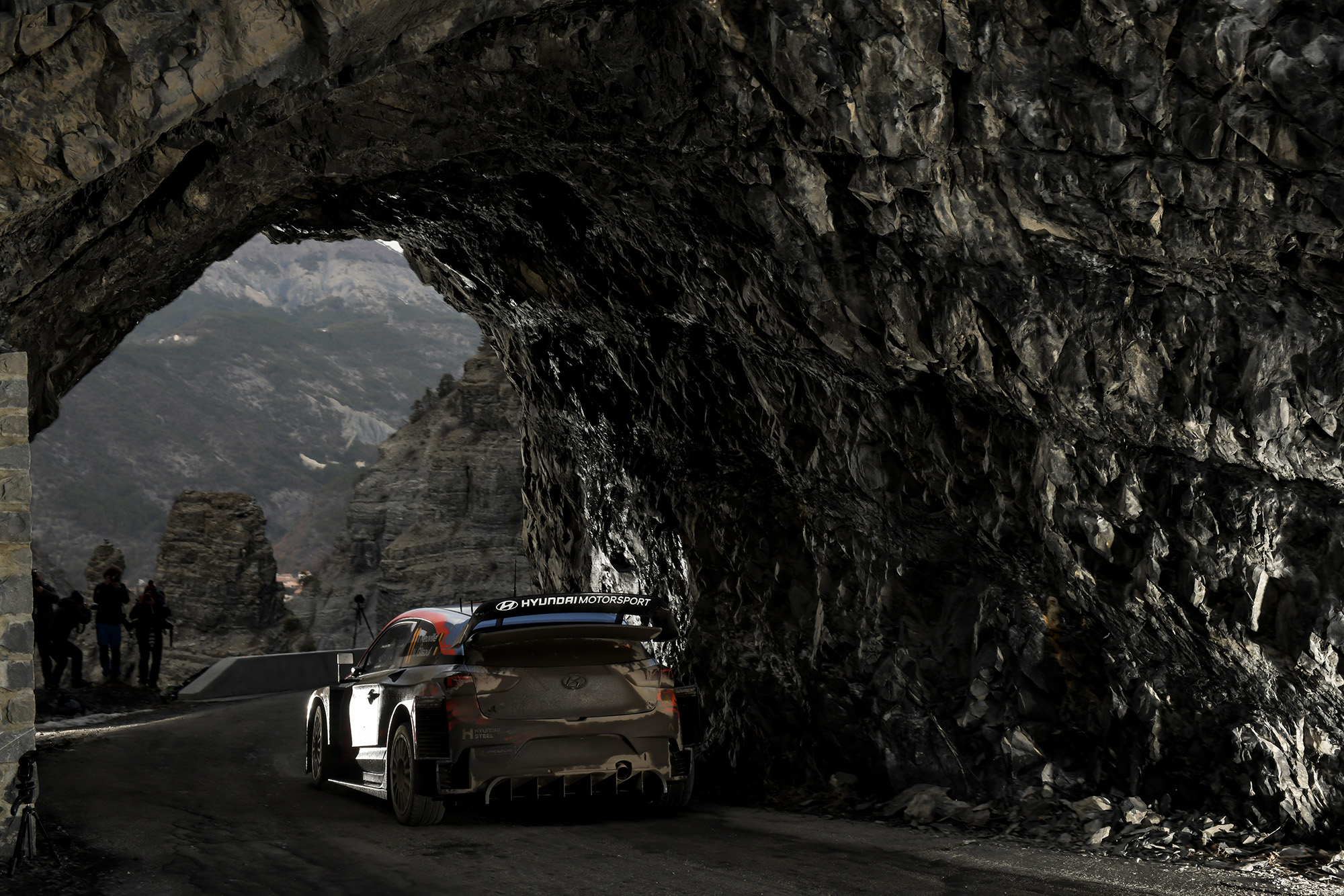 Thierry Neuville drives under a rock arch in the Alpine stages of the 2020 Monte Carlo Rally