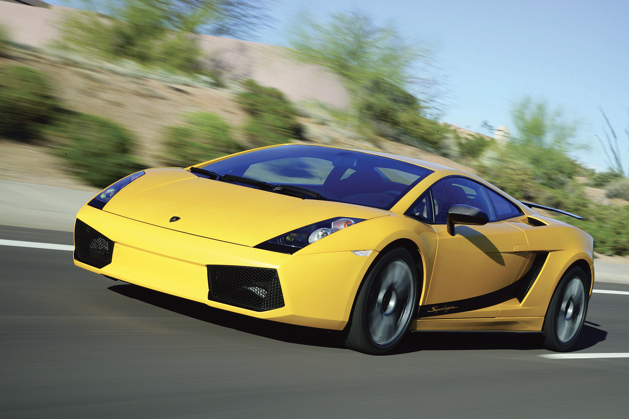 Yellow Lamborghini Gallardo on the road