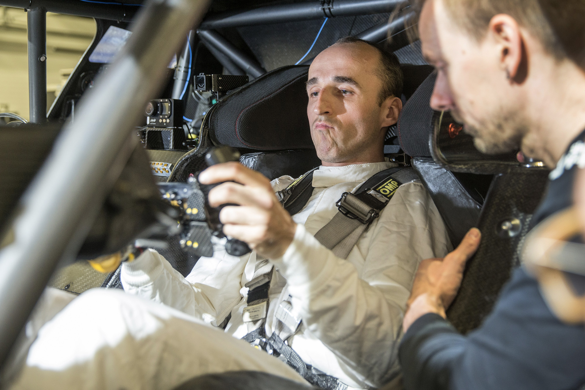 Robert Kubica in the cockpit of a BMW M4 DTM car