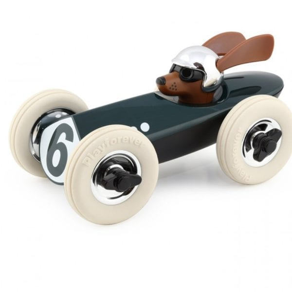 toy green racing car model driven by a dog