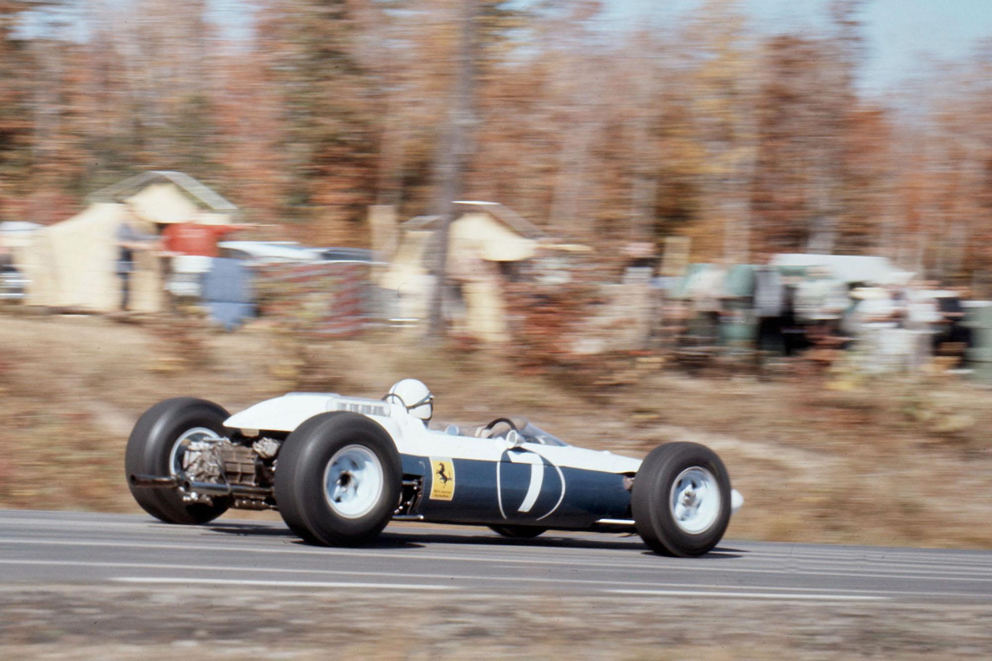 John Surtees driving for Ferrari at the 1964 United States Grand Prix.