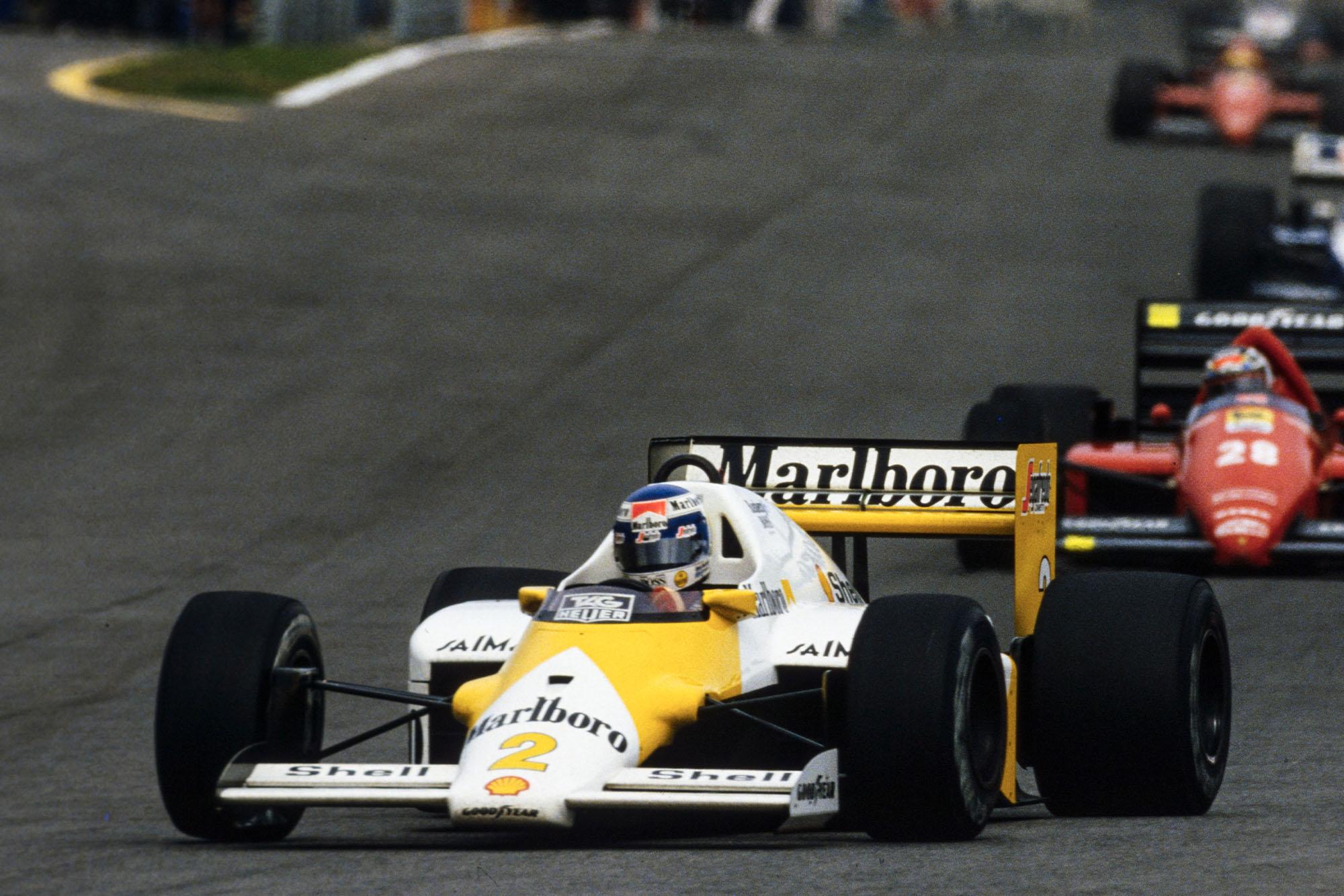 Keke Rosberg, McLaren MP4-2C TAG, leads Stefan Johansson, Ferrari F1/86.