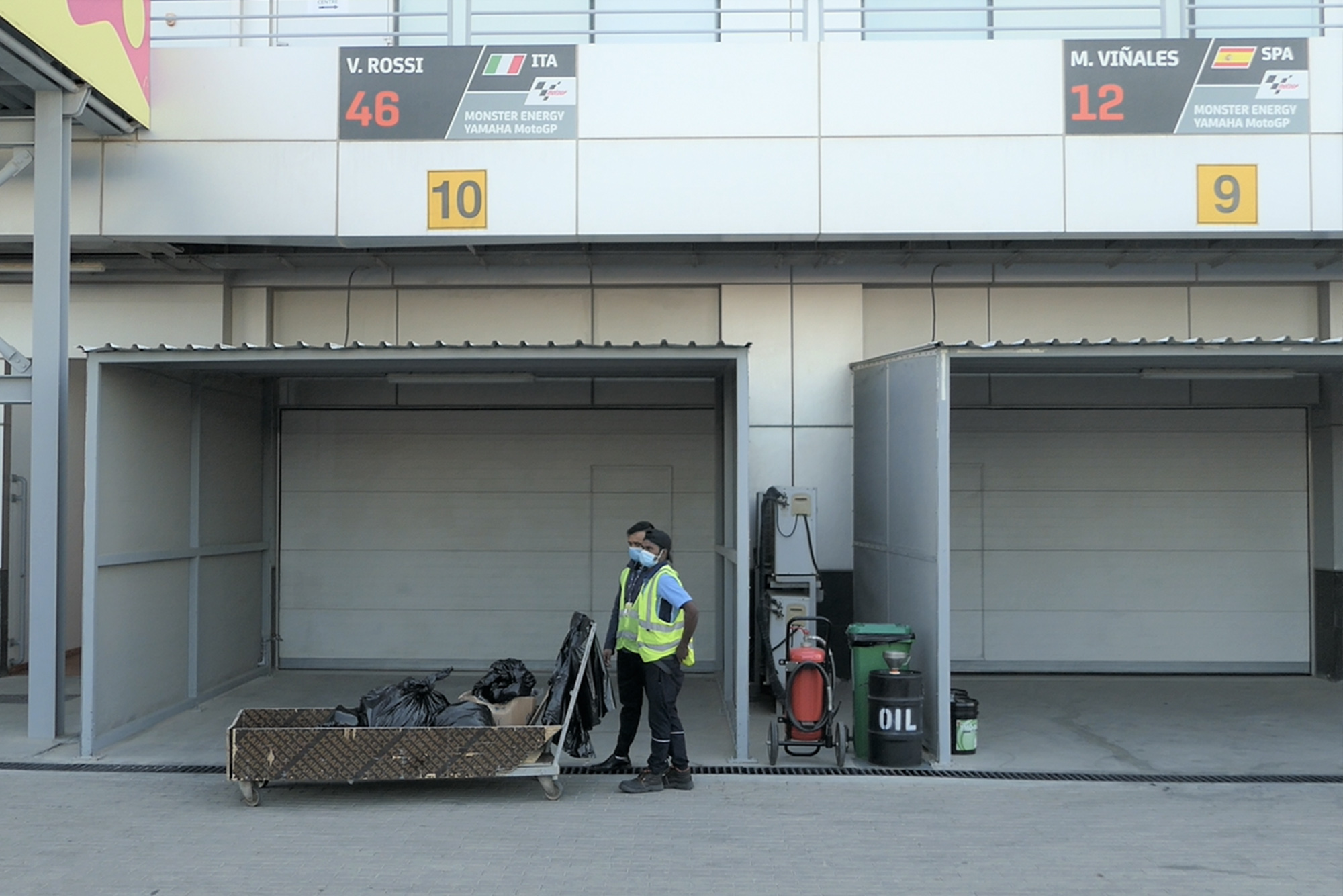 Workers clear out pit garages uring the 2020 MotoGP Qatar Grand Prix