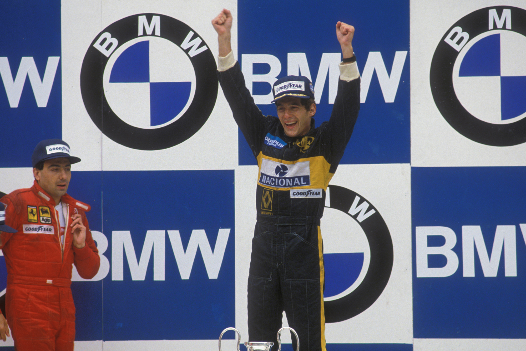 Ayrton Senna celebrates his first race victory in the 1985 Portuguese Grand Prix