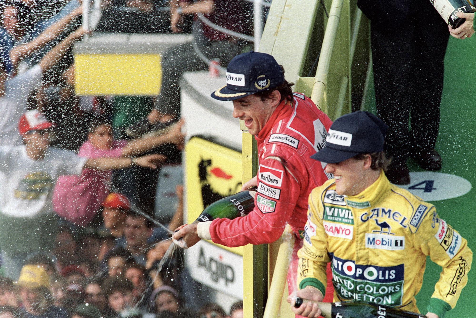 Ayrton Senna sprays champagne alongside Michael Schumacher after winning the 1992 Italian Grand Prix