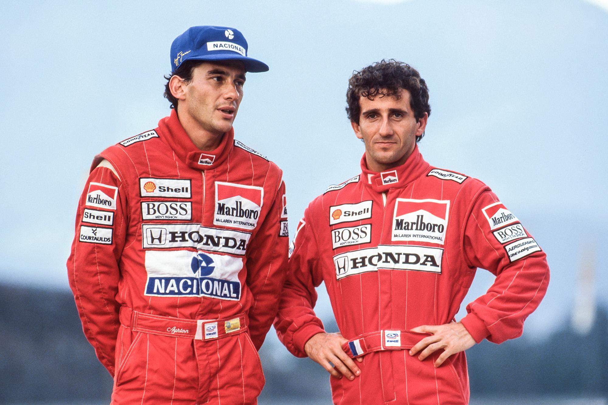 Ayrton Senna stands next to Alain Prost at the 1989 McLaren team photoshoot GPP